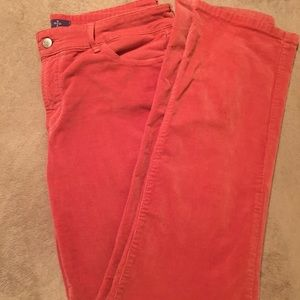Coral colored corduroy pant.